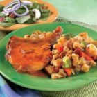 Baked Pork Chops with Garden Stuffing - Herb-seasoned stuffing mixed with colorful vegetables make a savory bed for tender, oven-baked pork chops topped with a golden mushroom sauce.