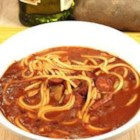 Spicy Red Bean Soup - Portuguese linguica and chourico sausages are cooked in a tomato broth seasoned with onion soup mix, in this soup thickened with pureed red beans, potatoes and broken spaghetti noodles.