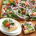 Greek Appetizer Flatbread - Greek seasoning, spinach, kalamata olives and tomatoes offer traditional Greek flavors in this easy-to-assemble appetizer flat bread.