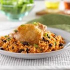 Hunts(R) Arroz con Pollo y Frijoles Negros - Rice and beans cooked with tomato sauce and seasoned chicken for a one-skillet dish.