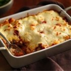 Progresso(R) Baked Ziti Casserole - Ziti pasta in a creamy tomato sauce with sausage and fresh herbs is baked in a casserole with ricotta and mozzarella cheese for a quick and hearty weekday dinner idea.