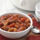 Slow Cooker Beef Stew - Tender onions, carrots and potatoes slow cooked with chunks of beef in a beefy tomato broth.