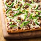 Philly Cheese Steak Pizza from Pillsbury(R) - Enjoy this hearty beef and cheese pizza made using Pillsbury(R) refrigerated classic pizza crust – dinner's ready in just 50 minutes.