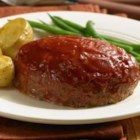 Classic Mini Meatloaves - Delicious mini meatloaves glazed with rich ketchup before baking for easy prep.