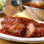 Beef Braciole - It may be one of the simplest dishes in Italian cooking, but it's really tasty. Thinly sliced beef is rolled around a mixture of sauteed veggies and bread crumbs and served in a red sauce....sounds good, doesn't it?