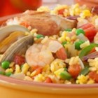 Paella by Filippo Berio(R) - This Spanish-inspired shellfish, chicken, vegetable, and rice classic is seasoned with savory herbs and spices and is easily prepared in the oven.