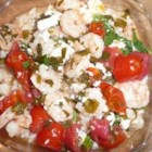 Greek Shrimp Dish From Santorini - An authentic Greek entree that is easy to make and makes you feel like you are in the Greek islands. My sister and I originally ate this dish at a restaurant in Santorini, Greece and went back 3 days in a row to order it again and analyze the ingredients so we could replicate it at home. It is easy to prepare ahead of time and stick in the oven so your cooking is complete before guests arrive! Serve over rice.