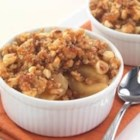 Sister Schubert's(R) Caramel Apple Crisp - Sliced apples are topped with crumbled Parker House rolls, nuts and spices in this delicious crisp. Drizzle with caramel apple dip and top with ice cream while it's still warm from the oven.