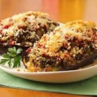 Mama Chiarello's Stuffed Eggplant - In this Italian-inspired dish, eggplant halves are filled with a savory mixture of browned beef, bell pepper, fresh herbs, cheese and bread crumbs, then topped with tomatoes and more cheese and baked until tender.