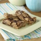 Peanut Butter Cereal Bars - A perfect afternoon pick-me-up for kids and adults alike, these bars are made of whole wheat cereal, peanut butter, and chocolate chips.