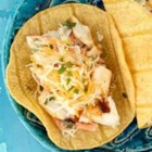 Baja Fish Tacos from KRAFT(R) - Spicy seasoned fish fillets are quickly pan fried and served in warm corn tortillas with lime juice, a creamy lime-seasoned coleslaw blend, and shredded cheese.