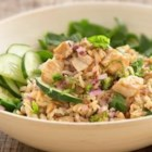 Thai Salad with Whole Grain Brown Rice and Chicken - Begin with Uncle Ben's(R) Rice and end up on a culinary trip to Thailand. Peanut sauce and spinach meet for an exotic plate of Thai salad with healthy whole grain brown rice and delicious basil seasoned chicken.