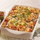 Enchilada Pasta Bake - Mexican-inspired flavors of black beans, taco seasoning, and cilantro spice up this easy and colorful pasta casserole made with cooked chicken and Tex Mex-style shredded cheese.