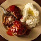 Cheese-Stuffed Giant Meatballs - Progresso® bread crumbs and Progresso™ Recipe Starters™ fire roasted tomato cooking sauce provide simple additions to these cheese-filled meatballs.