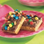 Peanut Butter Fudgy Bars - Two favorite snack flavors -- peanuts and chocolate -- are layered in these sweet and nutty bar cookies.