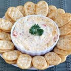 California Party Spread from Town House(R) - Chopped artichoke hearts, tomatoes, jalapenos, and grated Parmesan cheese in a creamy base is baked until lightly browned for a perfect party dip.