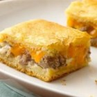 Sausage and Cheese Crescent Squares from Pillsbury - Sausage and two kinds of cheese turn crescent dough into a rich and tasty appetizer.