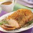 Dijon-Herb Pork Roast - An herb-studded pork roast wears a coat of crunchy bread crumbs and a sweet and tangy mustard and currant jelly sauce.