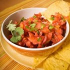 Strawberry Salsa - Fresh strawberries--paired with traditional salsa ingredients, like jalapenos, tomatoes and lime--take a bit of the bite out of what is ordinarily a fiery condiment.