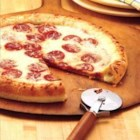 Stuffed-Crust Pizza - How clever! Roll Pillsbury(R) refrigerated pizza crust around string cheese for a pizza with pizzazz.