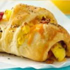 Bacon, Egg and Cheese Sandwiches - Breakfast ready in 30 minutes! Enjoy these delicious crescent shape sandwiches filled with bacon, egg and cheese made using Pillsbury(R) dinner rolls.