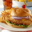 Midwestern Pork Tenderloin Sandwich - The 'tender' in the name of this sandwich refers to the ease with which you can sink your teeth into it. The cut of pork is actually boneless loin, 'tenderized' with a meat mallet. Serve these monster sandwiches with sliced tomato, sweet onion and lettuce.