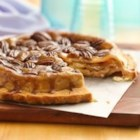 Topsy-Turvy Apple Pie - Brown sugar and pecans make the crust special. After baking, the pie gets a twist: it's turned upside down onto the serving plate, transforming the sticky bottom crust into a moist, nutty topping.
