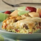 Sunday Brunch Bake - Feed a crowd with this delicious layered egg casserole with mushrooms, sausage, tomatoes, and cheese.