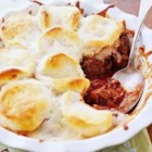 Upside Down Pizza Casserole - This quick pizza casserole can be altered easily. Substitute Italian sausage for the ground beef, or stir sliced mushrooms or ripe olives into the meat mixture.