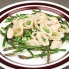 Pasta Milan - Rich and pungent Gorgonzola cheese is crumbled into heavy cream and tossed with hot pasta, peas and asparagus to make an opulent pasta dish for two.