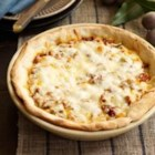 Chicago Deep-Dish Sausage Pizza - Premade pizza dough, flavorful Italian sausage, and a four-cheese blend make this classic pizza perfect for lunch or supper, and it takes less than an hour to get on the table.