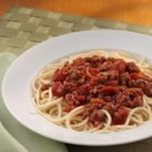 Classic Spaghetti Meat Sauce - Stewed tomatoes, tomato sauce and onion soup mix combine with ground beef for a super sassy sauce!