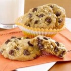 Peanut Butter Chocolate Cookies - Peanut butter, semi-sweet chocolate chips, and chopped peanuts make these cookies a perfect anytime treat.