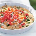 Tomato Topped Cheese and Bean Dip - A creamy blend of chickpeas, Mexican-style shredded cheese, and cream cheese with onions and spice makes a delicious hot dip.