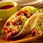Shredded Chicken Tacos - Bone and skin are left on the chicken breasts so they're extra flavorful as they simmer in tomato sauce and a blend of savory seasonings.