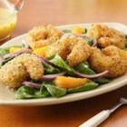 Crispy Seafood Salad with Citrus Vinaigrette - Large shrimp are coated with lemon pepper panko crumbs, quickly fried, then tossed with spinach, red onion, and orange sections in this bright and tasty seafood salad.