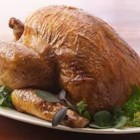 Chiarello's Herb Roasted Turkey - Rosemary, thyme, sage, and oregano--fresh herbs bring out the rich flavors of roasted turkey and vegetables served with lots of gravy.