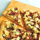 Luscious Artichoke Heart Pizza - Perk up your pizza with artichokes along with herbed cheese and Parmesan.