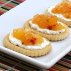 Mango Chutney on Town House Toppers(TM) - For delicious party canapes, spread cream cheese on buttery crackers and top with a sweet and savory mango chutney made with fresh ginger.