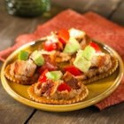 Fiesta Chicken Salad from Town House(R) - Chopped spicy grilled chicken is mixed with avocado and tomato chunks and served on crackers over a layer of refried beans.