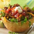 Grands!(R) Biscuit Taco Cups - Refrigerated biscuits make a grand holder for taco filling and all its trimmings!