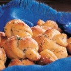 Parmesan Knots - In Parkersburg, West Virginia, Cathy Adams uses refrigerated biscuits to make a big batch of these buttery snacks. They're handy to keep in the freezer and a snap to reheat and serve with a meal.