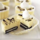 OREO Mini PHILLY Cheesecakes - Whole Oreo cookies make a fun and tasty crust for chocolate-topped mini cheesecakes.