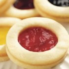 Shortbread Jamwiches - These tiny cookies can be filled with your favorite Smucker's jam or jelly. The dough is a rich, buttery shortbread. This recipe makes a lot of cookies so there will be plenty on hand for the holidays.