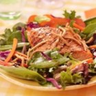 Grilled Salmon, Snap Peas and Spring Mix Salad with Chow Mein Noodles - Salmon fillets are grilled and brushed with an Asian-inspired sauce then served on fresh salad greens with snap peas tossed with Asian Vinaigrette.