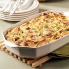 Brunch Strata - Ham, zucchini, mushrooms and cheese flavor this rich, hearty egg dish. It adds appeal to a breakfast or lunch buffet and cuts easily, too. Make sure you bring the recipe--everyone will want it! --Arlene Butler, Ogden, Utah