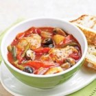 French Chicken Stew - Layer this chicken and vegetable stew recipe in your slow cooker and let the delectable aroma greet you when you arrive home to a ready-made meal.