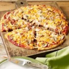 Bacon-Mushroom Pizzeria Pizza - This pizza, made with Cheddar and mozzarella cheese plus bacon, is a savory, flavorful dish that's perfect for a quick lunch or supper.