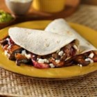 Mushroom and Onion Vegetarian Tacos - Vegetarians and meat-lovers will both love these delicious tacos. Mushrooms provide 'meaty' and filling flavor, balanced out by sweet caramelized onions.