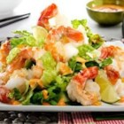 Spicy Shrimp with Bang Bang Sauce - Spicy shrimp are roasted and served over lettuce, topped with crushed potato chips, and served with a zesty hot sauce.
